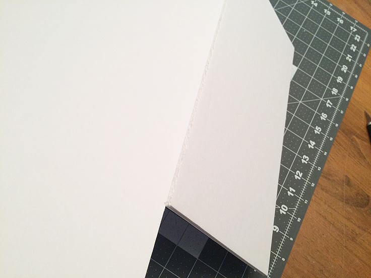 Folding the sides of the DIY storage boxes