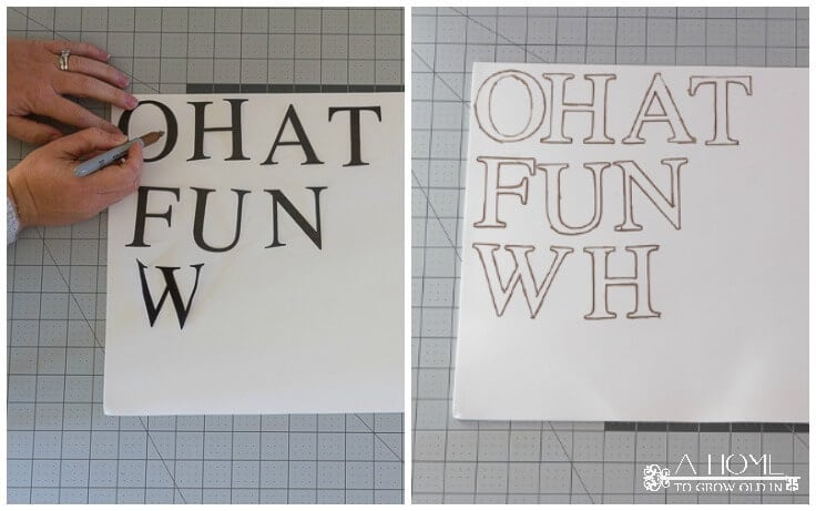 Tracing letters onto pieces of foam board for a DIY holiday banner.