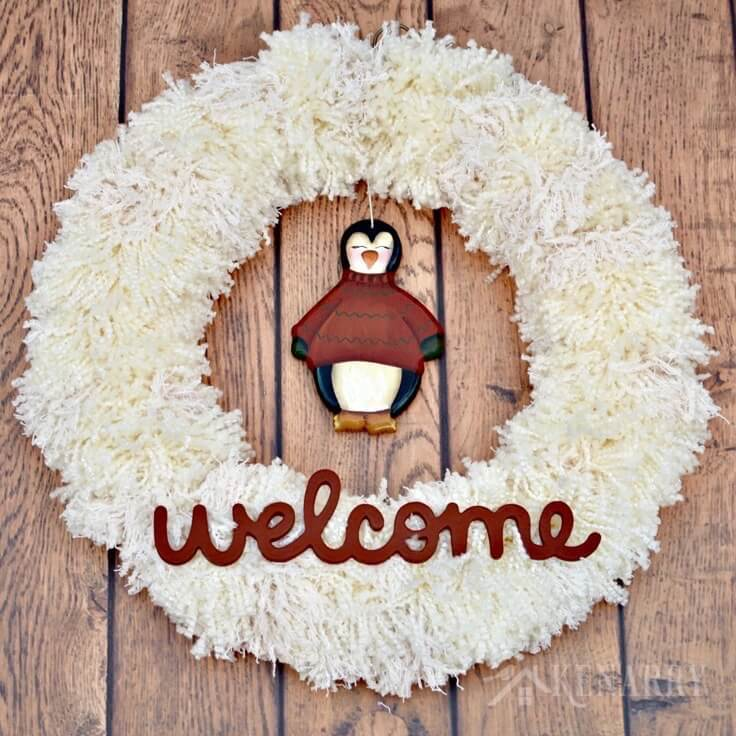 This white winter yarn wreath idea is gorgeous. It looks like an easy craft to make. I love how fuzzy and cozy it is as DIY home decor for Christmas or winter.