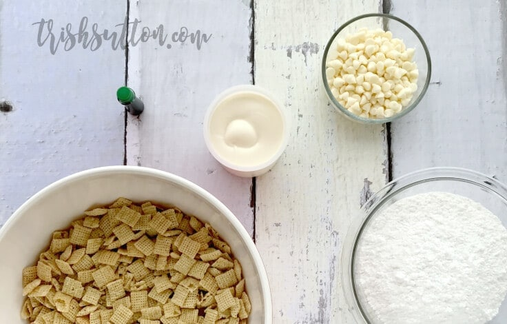 ingredients in bowls to make green puppy chow with Chex