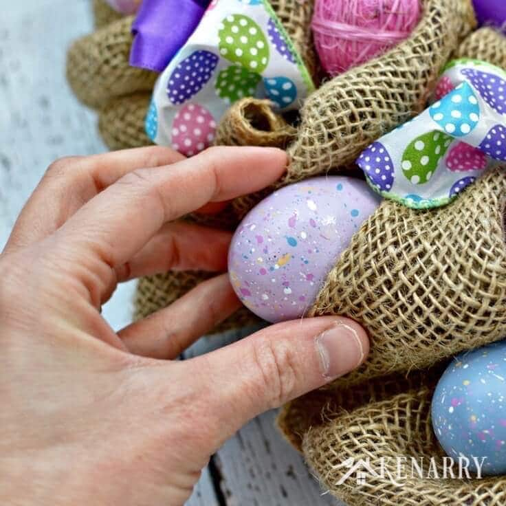 Adding Easter eggs to the burlap wreath