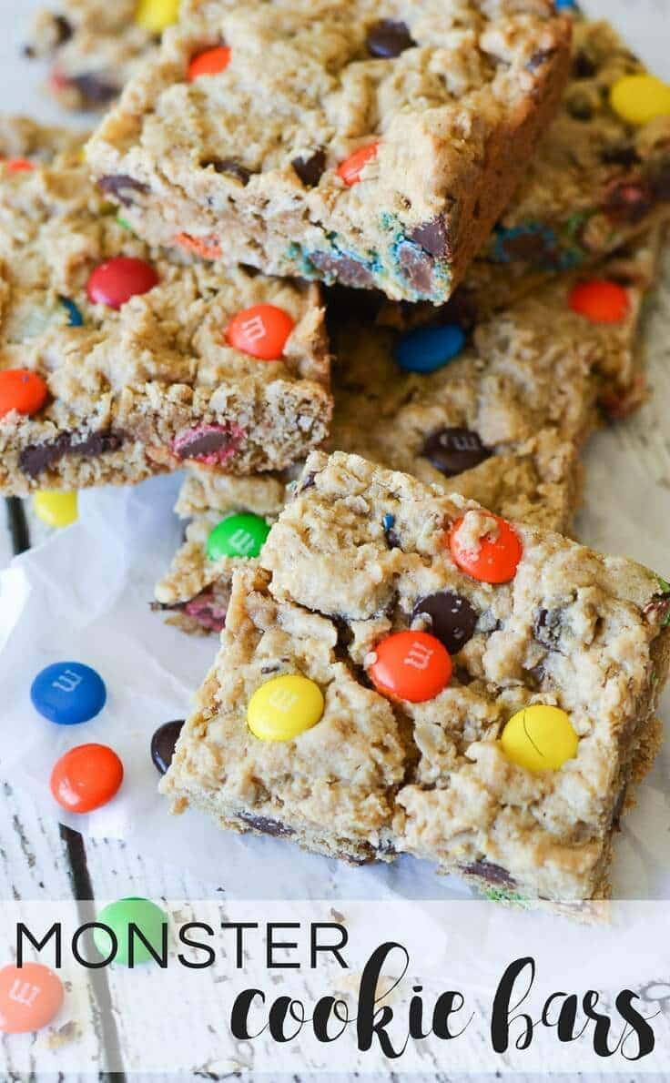 These chocolate chip, peanut butter, and M&M Monster Cookie Bars are an easy to make recipe with the perfect combination of soft and chewy packed into bite-sized bars. #cookiebars #desserts #kenarry
