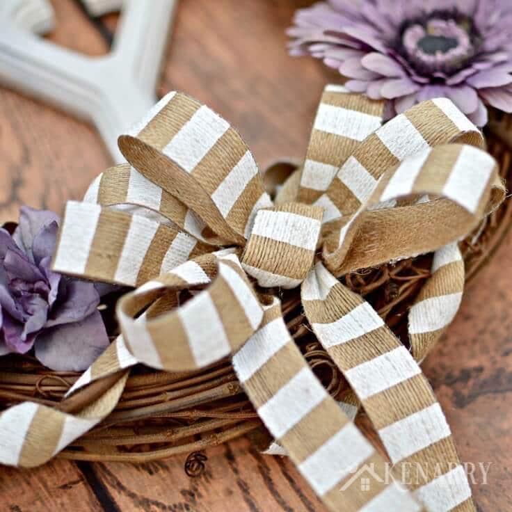 The burlap bow on the grapevine wreath