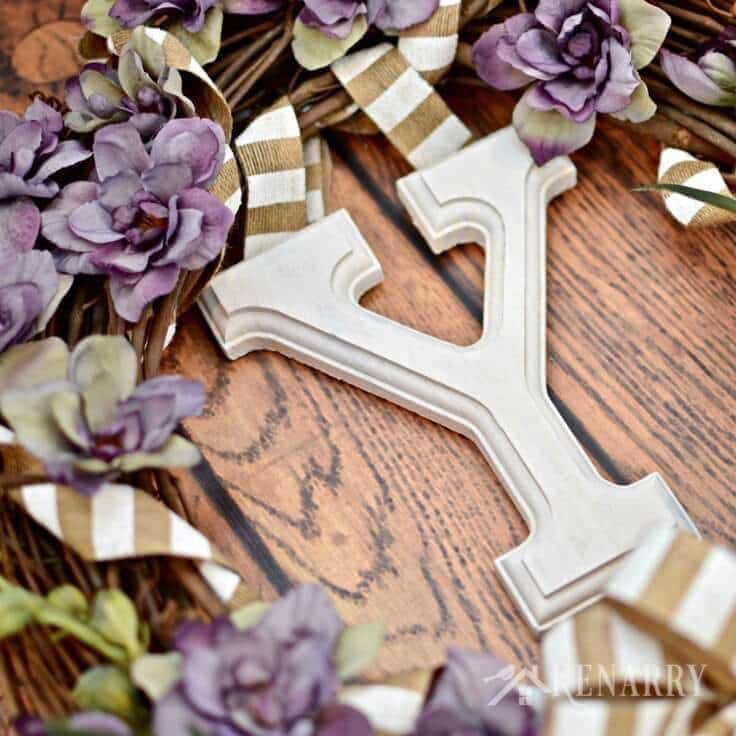 The letter Y hanging from the grapevine wreath