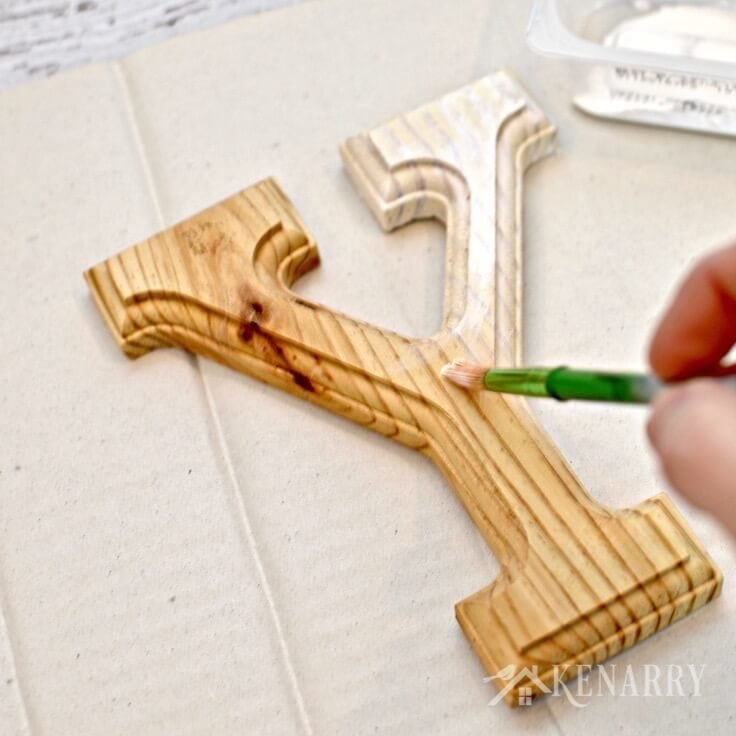 Whitewashing a wooden letter Y