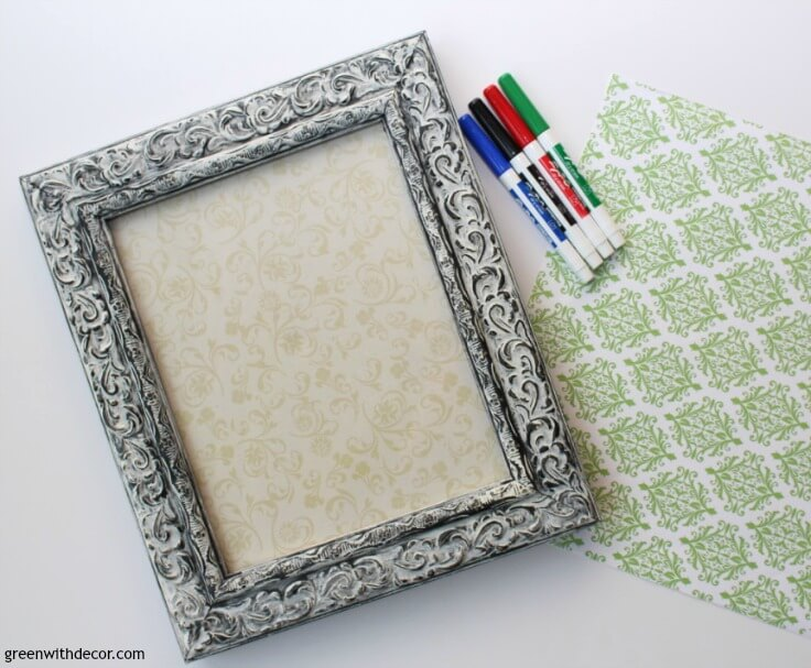 A picture frame, scrapbook paper, and dry erase markers