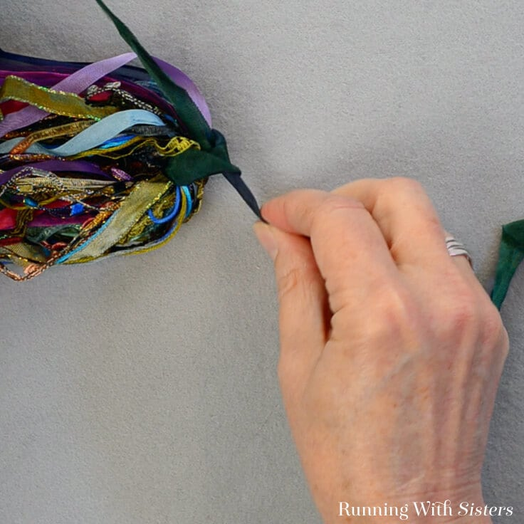 Make a trendy DIY tassel using leftover ribbons and trims. Perfect to hang on your purse, a doorknob, or even your journal!