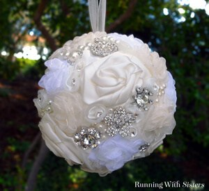 Make a kissing ball from vintage brooches and white ribbon roses. A perfect gift for a bride on her wedding day!