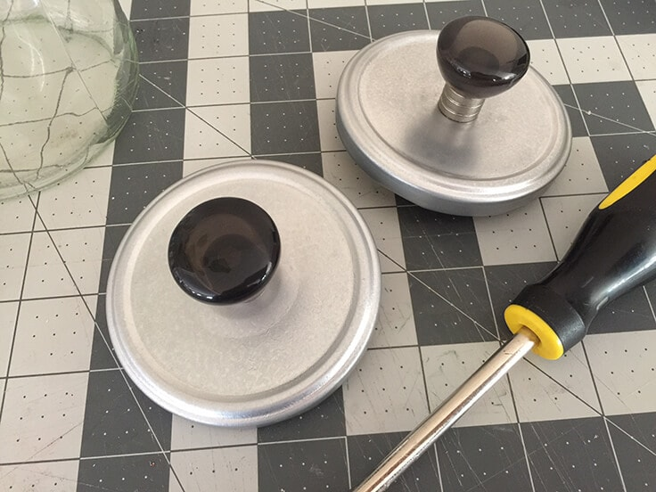 two knobs attached to silver lids.