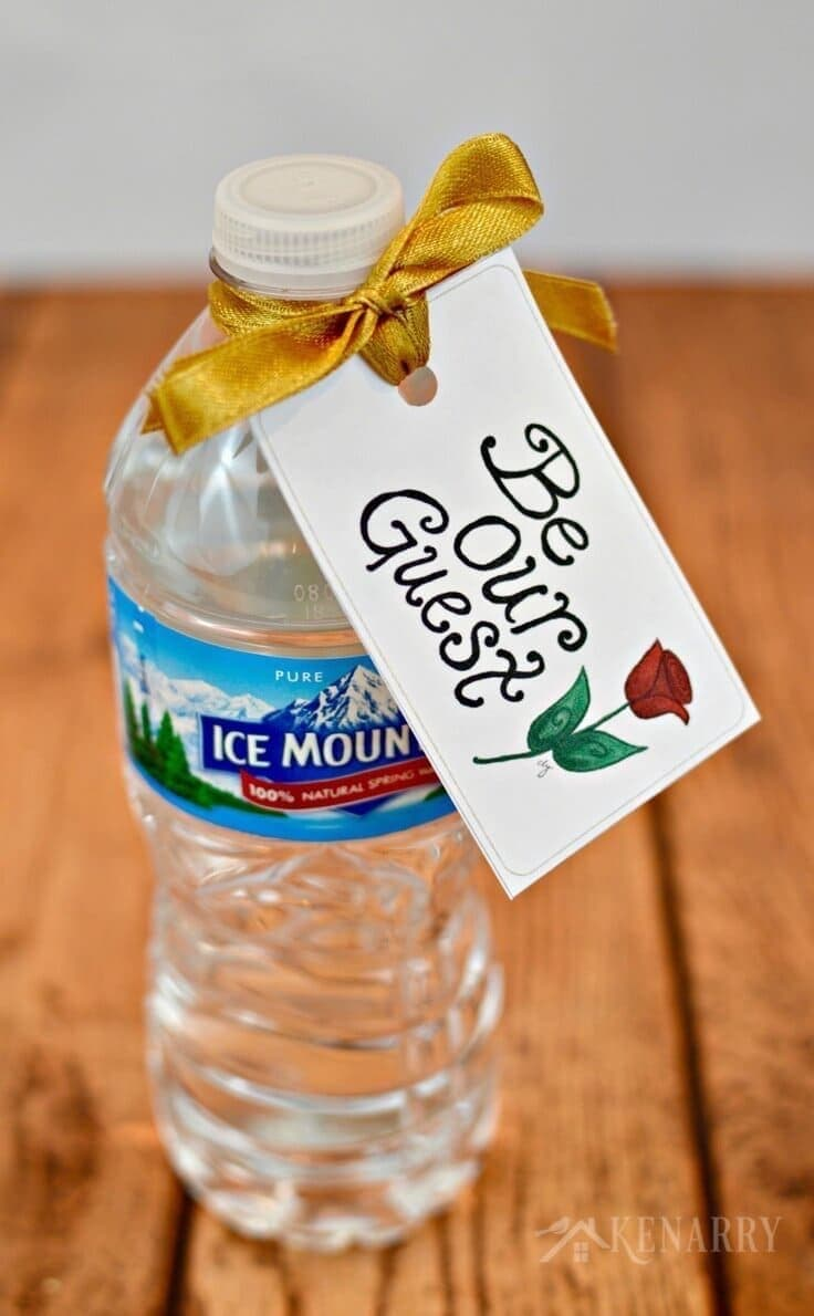Attach these free printable Be Our Guest tags to water bottles as Beauty and the Beast party favors for your Disney themed wedding or Disney princess birthday party -- or put it on a nightstand for people staying in your guest room.