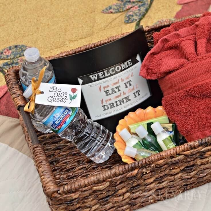 Create a welcome basket for people who stay in your guest room using these free printable Be Our Guest tags attached to a water bottle and this free printable welcome sign.