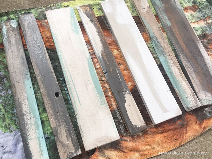 Painted and stained wood to look like weathered barn wood.