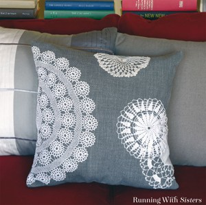 Dress up throw pillows with vintage lace doilies!