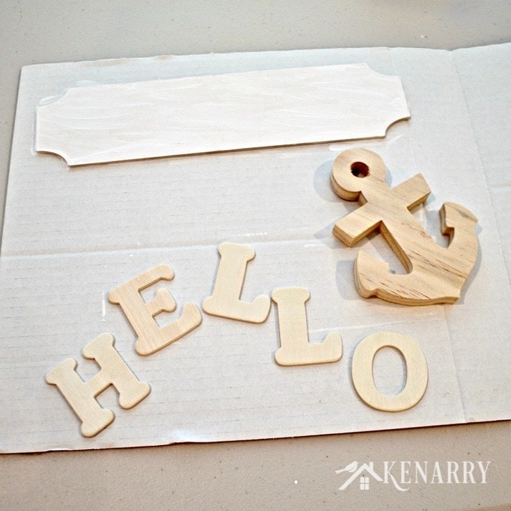 Wood letters and a wood anchor to use on a wreath