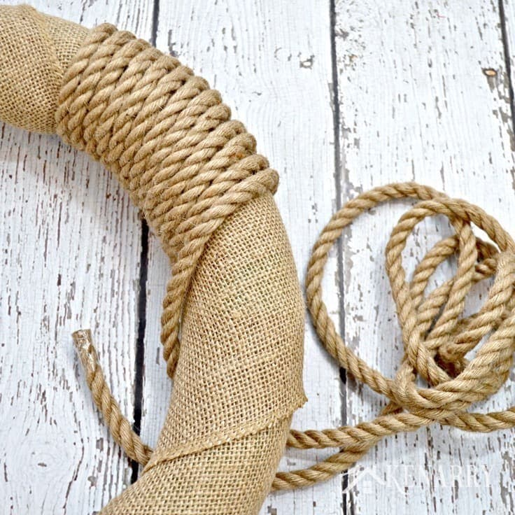Wrapping sisal rope around a burlap wreath
