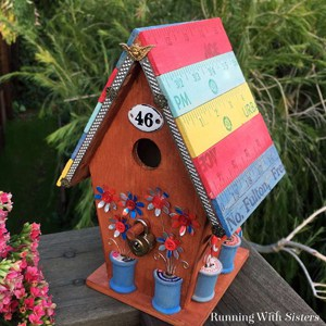 Decorate a wooden birdhouse with irresistible vintage finds like yardsticks, luggage locks, and wooden spools. We'll show you how!