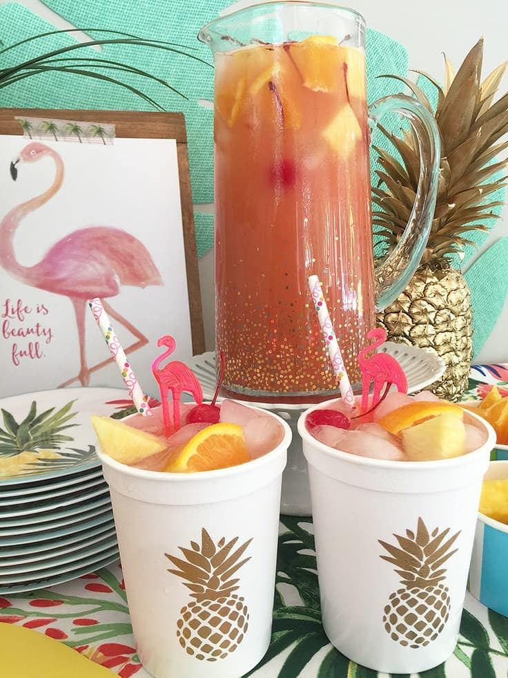 This trendy summer pink fruit punch is a fun, easy-to-make non-alcoholic beverage. It's perfect for a kid's luau birthday party, or add some rum for an adult-only alcoholic drink. #summer #cocktail #kenarry