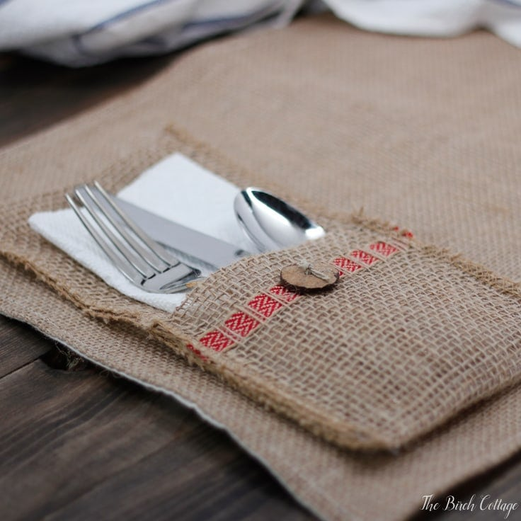 Make this easy to sew burlap utensil holder out of burlap ribbon. Follow this easy tutorial from The Birch Cottage to add a little bit of rustic charm to your tablescape!