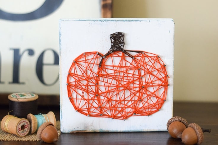 This pumpkin string art project is such a simple craft to make and will add the perfect pop of fall to your table or mantel!