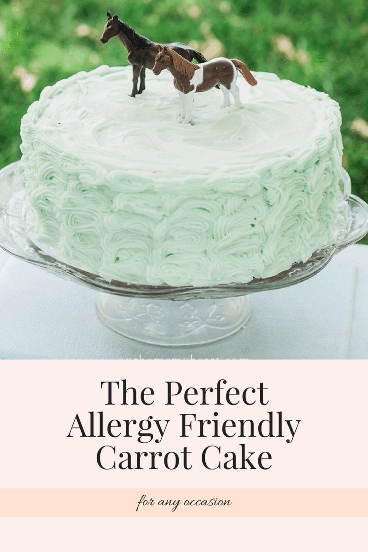 allergy friendly gluten free carrot cake with cream cheese frosting decorated with toy horses on top