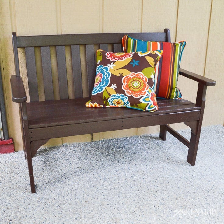 This brown polywood mission style bench adds a touch of comfort to the outdoors on a new craftsman style front porch added on to a cottage home | home idea | outdoor living | outdoor patio