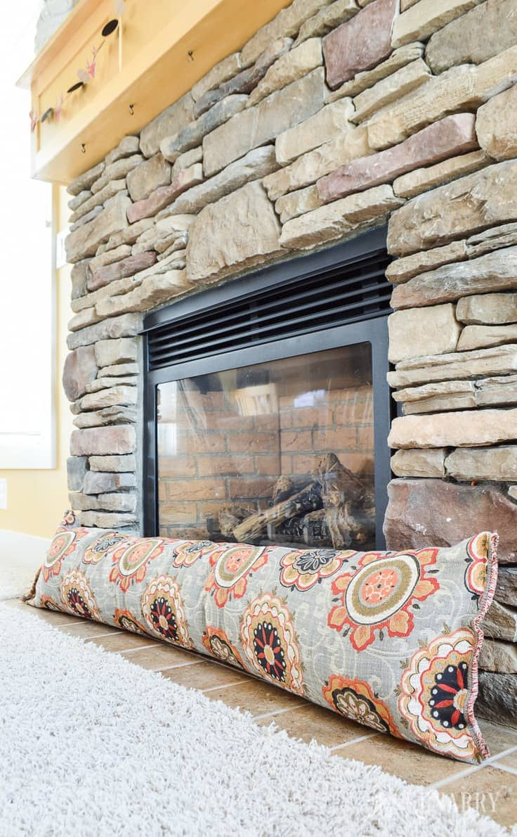 Got cold drafty air coming through your fireplace? Block it out by making a DIY fireplace draft stopper using this easy sewing tutorial. Using a draft blocker or door draft excluder also helps you to save on heating costs. draft stopper | draft protector | draft excluder | door draft blocker
