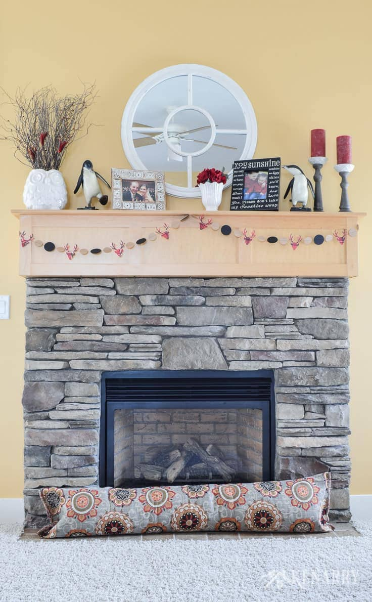 This winter fireplace keeps a home warm in winter, especially with a decorative fireplace draft stopper. You can easily sew your own draft blocker using upholstery fabric and this simple tutorial. It will help save heating costs and block cold air this winter. draft stopper | draft protector | draft excluder | door draft blocker
