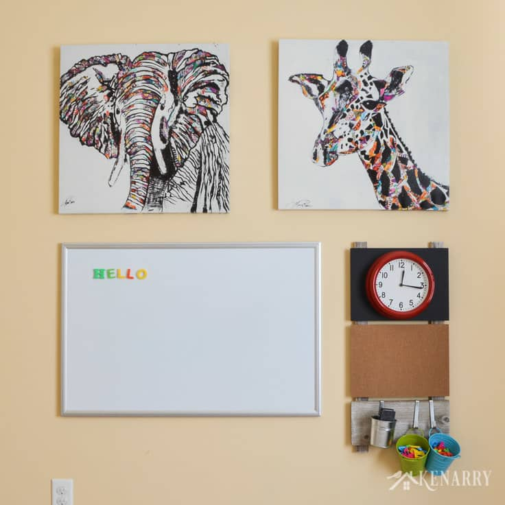 Create a fun gallery wall using kid's playroom wall decor, like a magnetic marker board, a corkboard and a bright red clock, along with colorful animal prints.