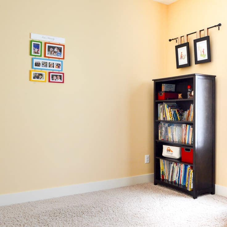 Before we created a gallery wall in the kid's room, the only playroom wall decor we had was a collage of family photos and a few Curious George prints.