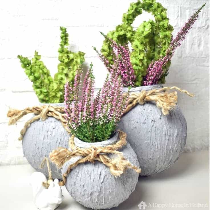How to create cement look vases from old ball lights in a few easy steps.