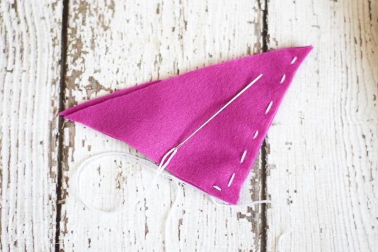 Sewing felt together to make a corner bookmark.