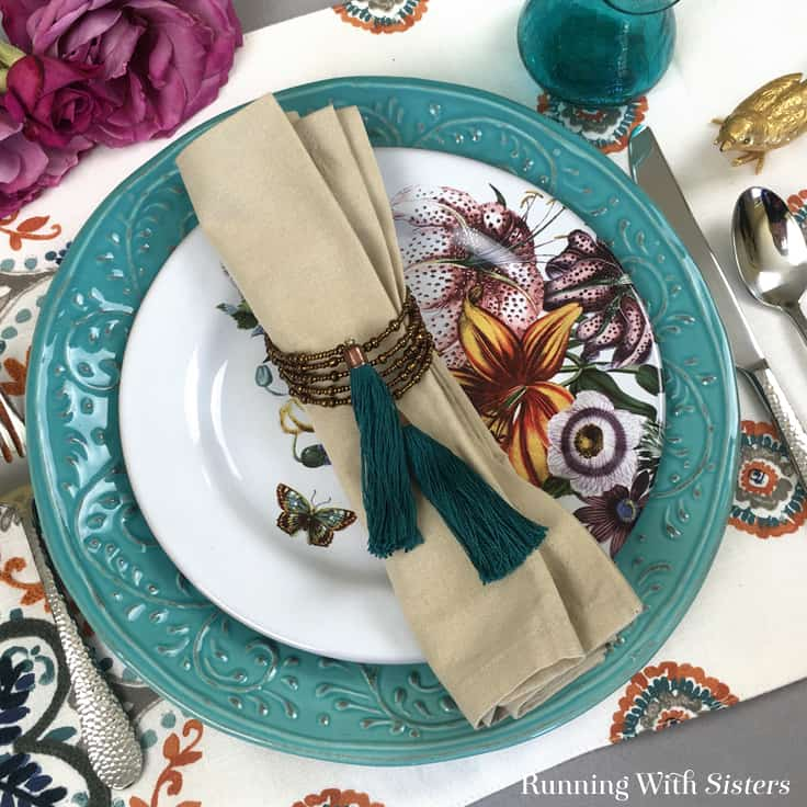 Learn to make DIY Bead And Tassel Napkin Rings. We'll show you every step including how to make handmade tassels made from embroidery floss!