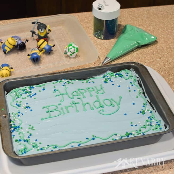 Use frosting and sprinkles to dress up a Minions Birthday Cake for a Despicable Me party.