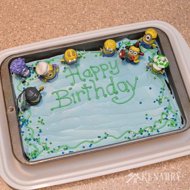 A plastic cake carrier with a lid keeps this Minions Birthday Cake fresh until it's time for the Despicable Me party.