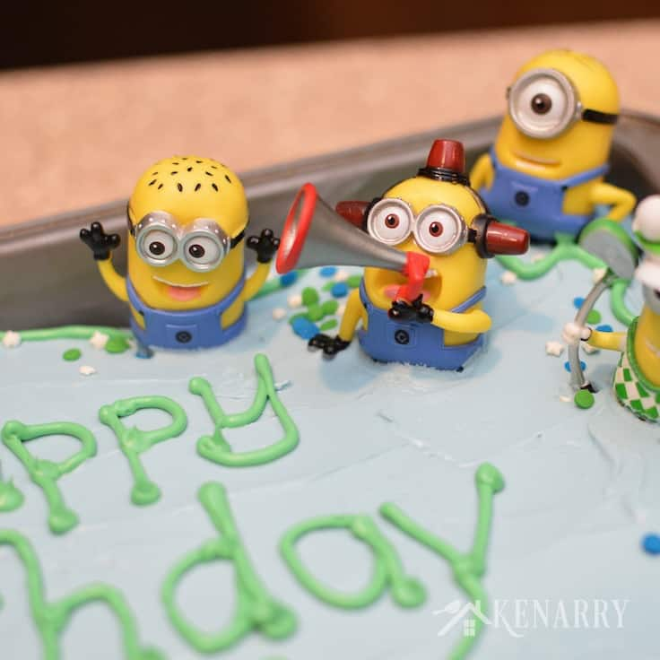 Young and old alike will love this Minions Birthday Cake. It's decorated with small Minions toys to create a festive dessert for a Despicable Me party.