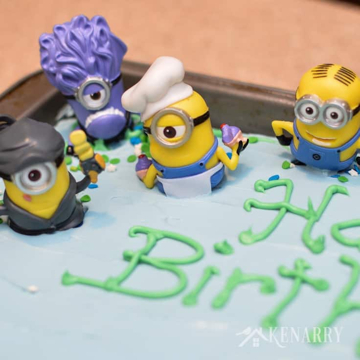 Small Minions toys are used as easy decorations for a Minions Birthday Cake. If you're hosting a Despicable Me party, this dessert will be perfect!