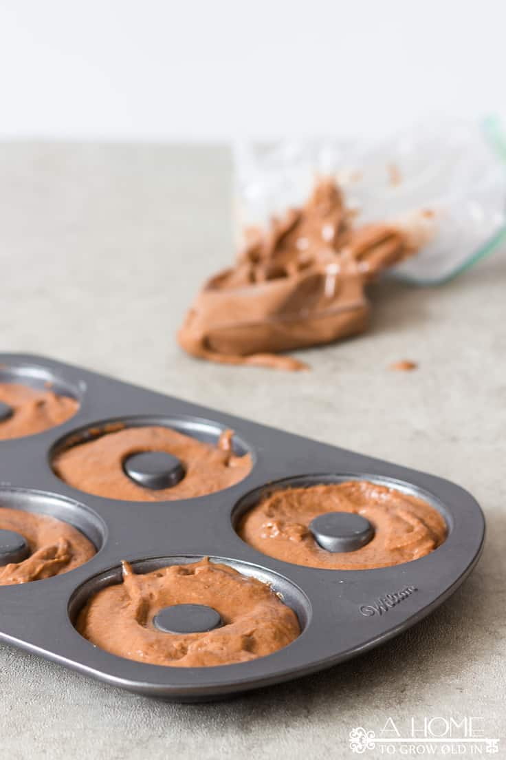 Chocolate donut batter in a donut pan