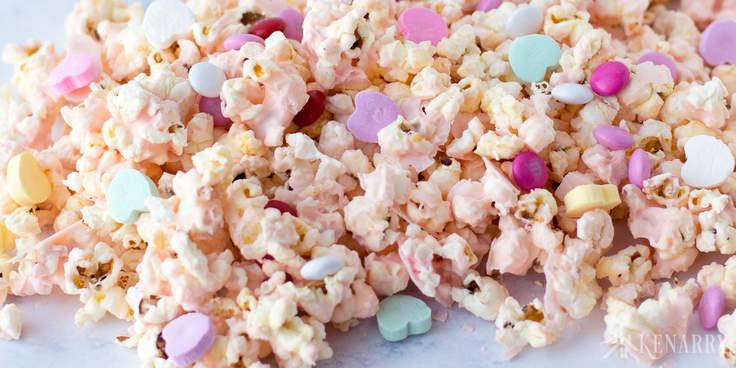 Conversation hearts and M&Ms add some festive fun to this Cupid popcorn, an easy Valentine's Day recipe for a sweet treat your kids will love.