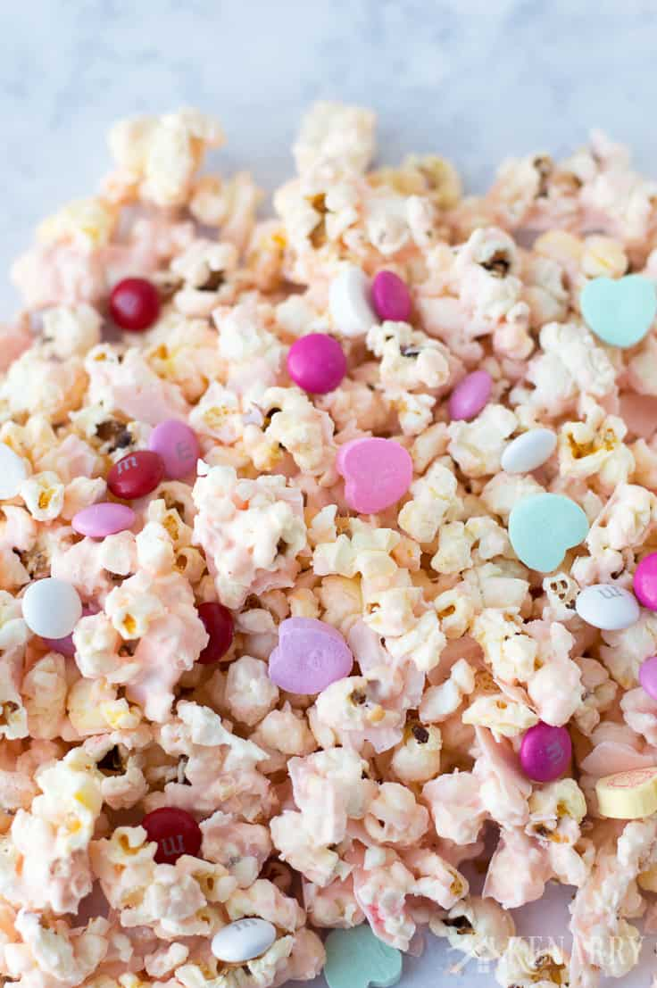 Make Cupid popcorn with candy hearts and chocolates for an easy Valentine's Day recipe your kids will love. It also makes a fun valentine gift for friends, neighbors or as a sweet treat for a school class party!