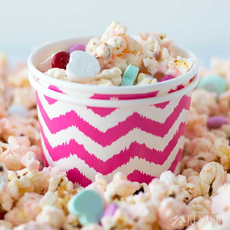 Dish up bowls of this festive and fun Cupid popcorn for your Valentine's Day party. This easy Valentine's Day recipe uses microwave popcorn, conversation hearts and candies. It's a fun valentine gift for friends, neighbors or as a sweet treat for a school class party!
