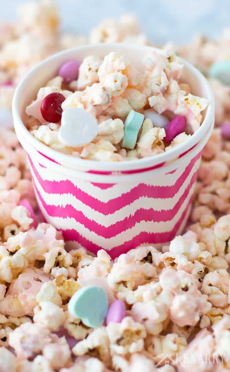 Bowls of delicious Cupid popcorn are a sweet treat for your class Valentine's Day party. This easy Valentine's Day recipe uses microwave popcorn, conversation hearts and candies.