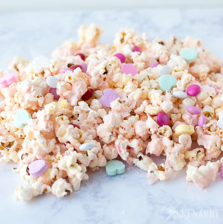 Cupid Popcorn will be a big hit with kids at the school class Valentine's Day party. This easy Valentine's Day recipe is fun and festive with conversation hearts and valentine M&Ms.