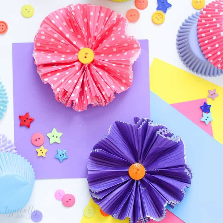 Make this cupcake liners flower craft to use for wreaths, centerpieces, banners, or even as a fun spring craft to make with the kids!