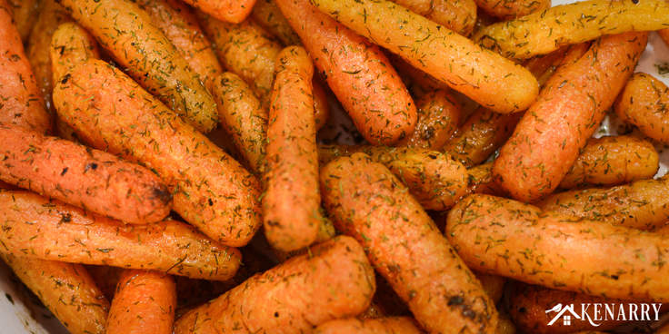 close up of roasted carrots with dill