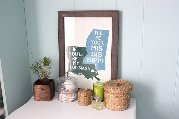 Use a houseplant to add greenery to a display in a master bathroom.