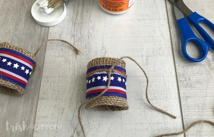 Repurpose paper rolls and decorate for summer at the same time with this simple tutorial for Upcycled Patriotic Burlap Napkin Rings.