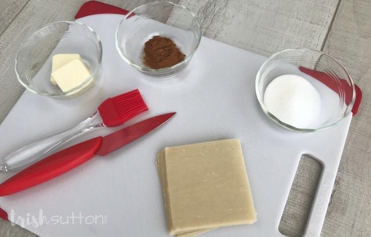 Ingredients for baked cinnamon chips - wonton wraps, cinnamon, sugar, butter.