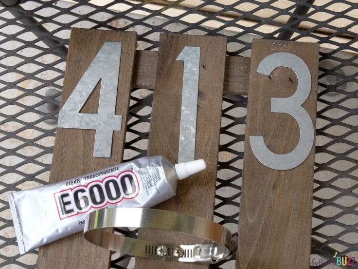use glue to attach numbers to the diy house number wall planter