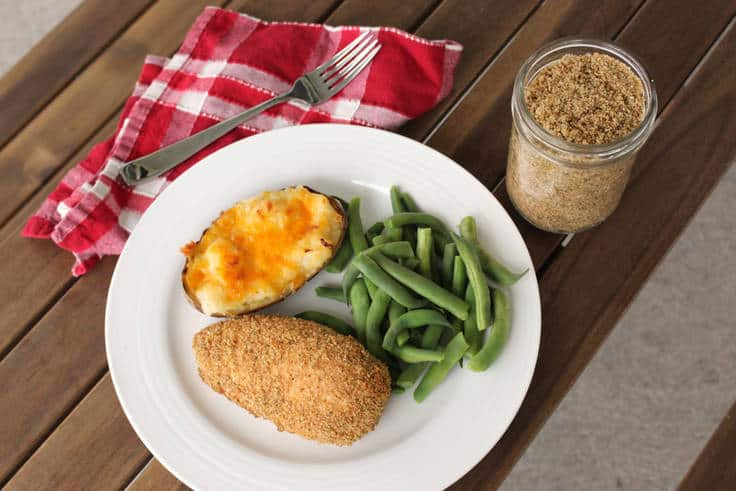 homemade shake and bake chicken recipe with green beans and potato on a white plate