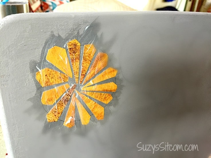 Putting paper on a tabletop to make it look like ceramic mosaic